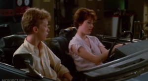 A young Anthony Michael Hall and Molly Ringwald bare their souls in an unfinished automobile.