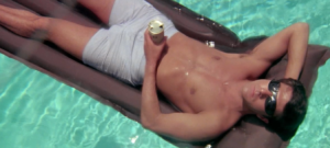 FIT AND SEXY. A young and aimless Dustin Hoffman lounges in his parent's pool.